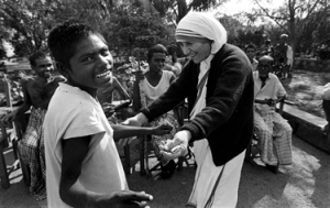 "Mother Teresa at Prem Dan, Mother Teresa''s Missions Of Charity, Calcutta, India, 1980 Mother Teresa: Untitled 39.  300A-019-009 Mother Teresa.  Prem Dan, Calcutta, India  1980 People Magazine. September 22, 1997. pp. 158-159 ""I see God in every human being,"" said Mother Teresa (visiting a Calcutta rehabilitation center in 1980."""